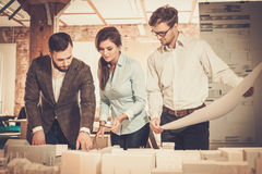 Confident team of engineers working together in a architect  studio. Confident team of engineers working together in a architect studio Stock Image