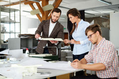 Confident team of engineers working together in a architect studio. royalty free stock photography