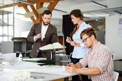 Confident team of engineers working together in a architect studio. stock photos