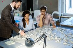 Confident team of engineers working together in a architect studio. stock images