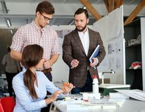 Confident team of engineers working together in a architect  studio. Confident team of engineers working together in a architect studio Royalty Free Stock Images