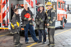 Confident Team Of Firefighters Against Truck Royalty Free Stock Photos