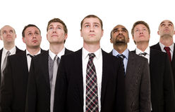 Confident team looking up Stock Photos