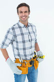 Confident technician holding spirit level Stock Photo