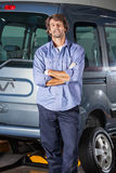 Confident Technician Leaning On Car Stock Photo
