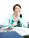 Confident teen girl studying at her desk Stock Photography