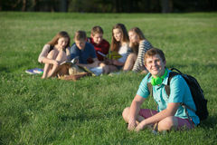 Confident Teen Student. Confident male teen student with backpack sitting outdoors Stock Photos