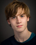 Confident Teenage Blond Young Man In The Studio Stock Images