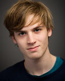 Confident Teenage Blond Young Man In The Studio Royalty Free Stock Photography
