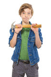 Confident teenage boy holding a hammer in front, isolated on whi Stock Photo