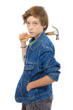 Confident teenage boy holding a hammer on his shoulder, isolated Royalty Free Stock Image