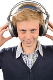 Confident teenage boy listening to music Royalty Free Stock Photo