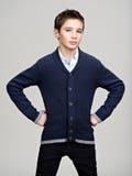 Confident teenage boy posing at studio Royalty Free Stock Image