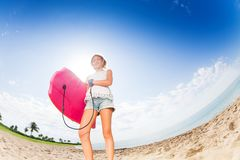 Confident teenager portrait with body board Stock Photos