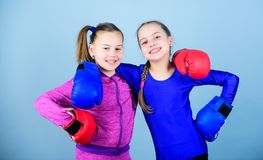 Confident teens. Female boxers. Boxing provide strict discipline. Competitors on ring and friends in life. Girls cute. Boxers on blue background. Girls in stock photos