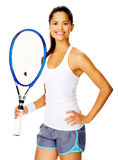 Confident tennis woman. Healthy happy confident woman with a wristband poses with a tennis racket Stock Image
