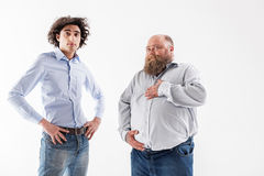 Confident thin and thick men posing Royalty Free Stock Photo