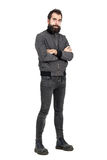 Confident tough punker in military boots and gray jacket with crossed arms looking at camera. Full body length portrait isolated over white studio background stock photos