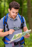 Confident tourist examining map. Stock Photo