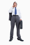 Confident tradesman with suitcase and jacket. Against a white background Stock Photography