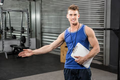 Confident trainer showing the gym to the camera. At the crossfit gym Royalty Free Stock Image