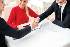 Confident transactions. Three successful and confident businessm Stock Photo