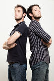 Confident Twins. Two Confident Twins with Arms Folded Stock Photography