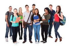 Confident university students walking over white background Royalty Free Stock Photo