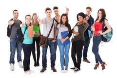 Confident university students walking over white background stock images