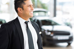 Confident vehicle salesman Royalty Free Stock Image