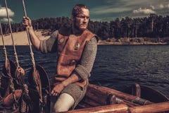 Confident viking man on Drakkar. Royalty Free Stock Photography