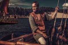 Confident viking man on Drakkar. Royalty Free Stock Photo