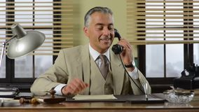 Confident vintage businessman working at desk stock video
