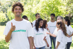 Confident volunteer showing thumbs up Stock Photography