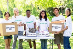 Confident volunteers with donation boxes Royalty Free Stock Photos
