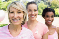 Confident volunteers participating in breast cancer awareness Stock Photos