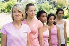 Confident volunteers supporting breast cancer awareness Royalty Free Stock Photography