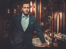 Confident well-dressed man in Luxury bathroom interior. Stock Photos