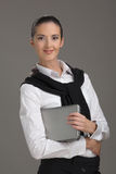 The confident woman. The young beautiful woman, smiling, holds laptop Royalty Free Stock Images