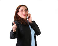 Confident woman. On the phone with thumb up, isolated on white Stock Photography