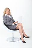 Confident woman. Sitting in an armchair Stock Photography