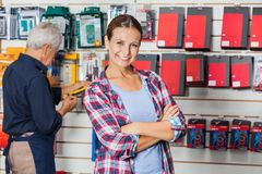 Confident Woman With Arms Crossed In Hardware Stock Photos