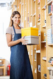 Confident Woman Carrying Boxes In Store Stock Images
