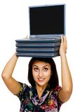 Confident woman carrying laptops Royalty Free Stock Photo