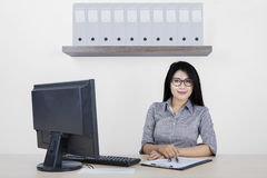 Confident woman with computer in office Royalty Free Stock Photos