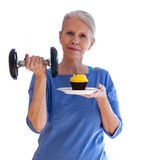 Confident Woman with Dumbbell and Cupcake Royalty Free Stock Images