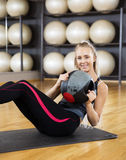 Confident Woman Exercising With Medicine Ball In Gym Royalty Free Stock Photos