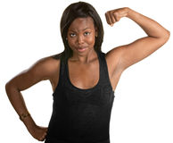 Confident Woman Flexes Her Bicep Stock Photo