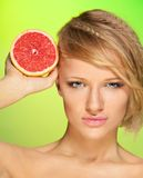 Confident woman with fruit Royalty Free Stock Photo