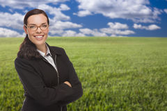 Confident Woman in Grass Field Looking At Camera Stock Photography